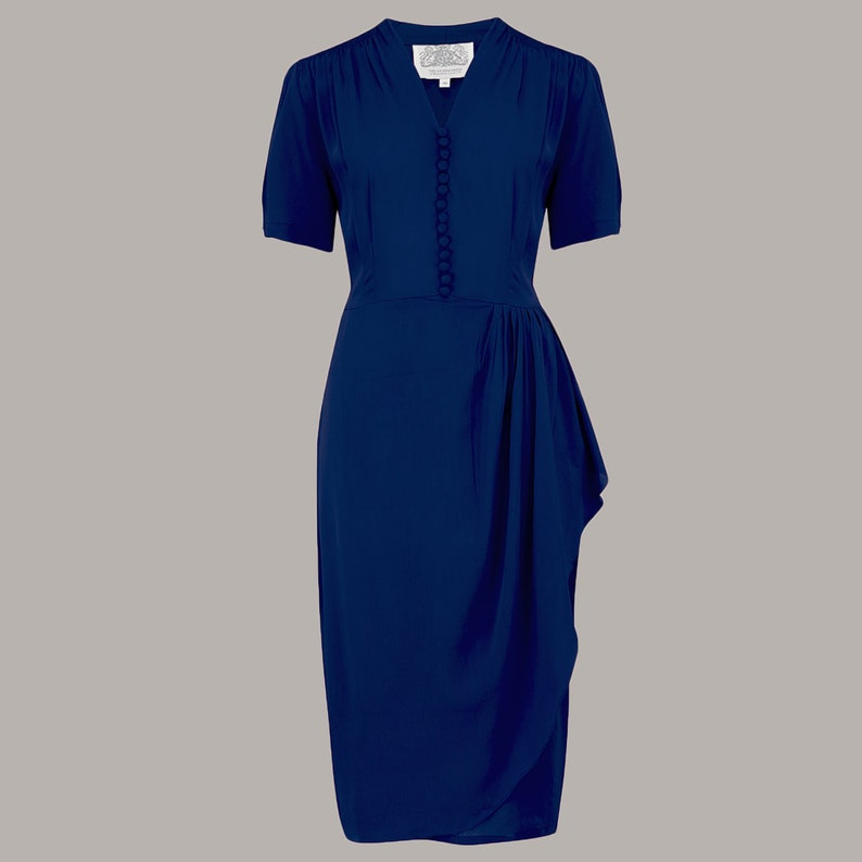 What Did Women Wear in the 1940s? 40s Fashion Trends Mabel Dress in Solid Navy by The Seamstress of Bloomsbury | Authentic Vintage 1940s Style $107.67 AT vintagedancer.com