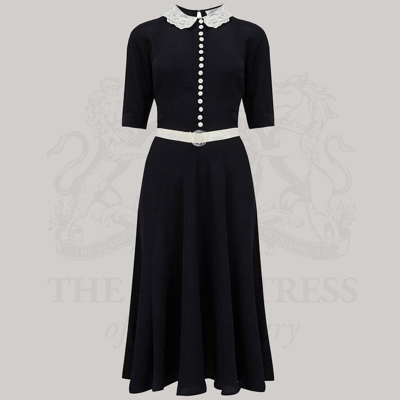 10+ Websites with 1940s Dresses for Sale Lace Collar Dress in Black by The Seamstress of Bloomsbury | Authentic Vintage 1940s Style $111.14 AT vintagedancer.com