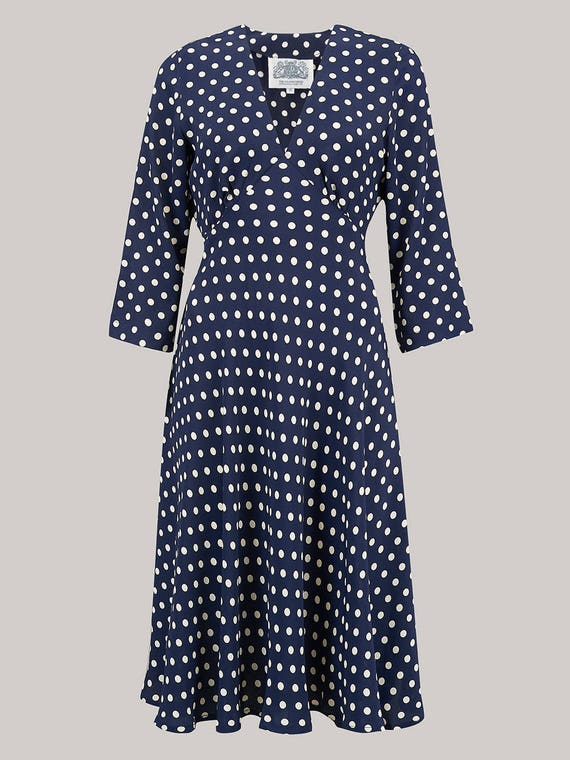 Polka Dot Dresses: 20s, 30s, 40s, 50s, 60s Lois Dress in Navy Spot by The Seamstress of Bloomsbury | Authentic Vintage 1940s Style $106.08 AT vintagedancer.com