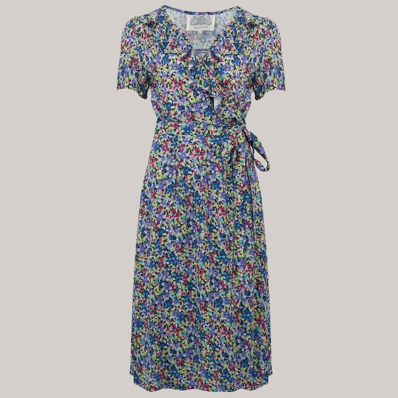 500 Vintage Style Dresses for Sale | Vintage Inspired Dresses Ruffle Collar Peggy Wrap Dress in Pansy Print by The Seamstress of Bloomsbury | 1940s Authentic Vintage Style Clothing $98.85 AT vintagedancer.com