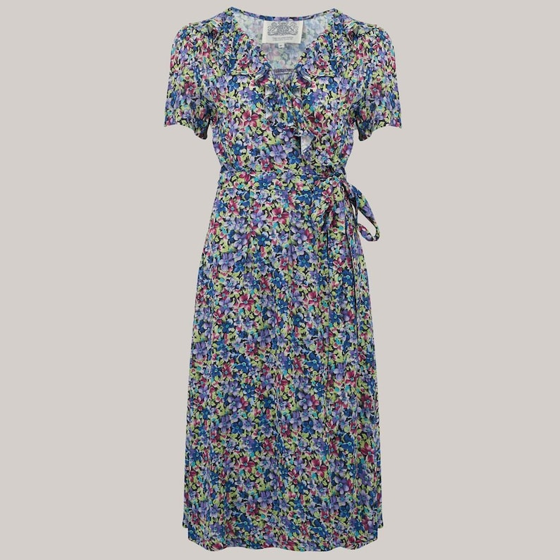 Swing Dance Clothing You Can Dance In Ruffle Collar Peggy Wrap Dress in Pansy Print by The Seamstress of Bloomsbury | 1940s Authentic Vintage Style Clothing $98.85 AT vintagedancer.com