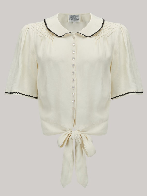 1940s Blouses, Shirts and Tops Fashion History Helen Blouse in Cream (Black Ric-Rac) by The Seamstress of Bloomsbury | Authentic Vintage 1940s Style $51.56 AT vintagedancer.com