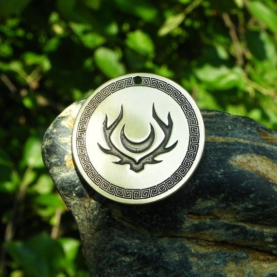 One Of The Symbols Of Artemis Amulet Goddess Of The Hunt Forests And Hills The Moon And Archery