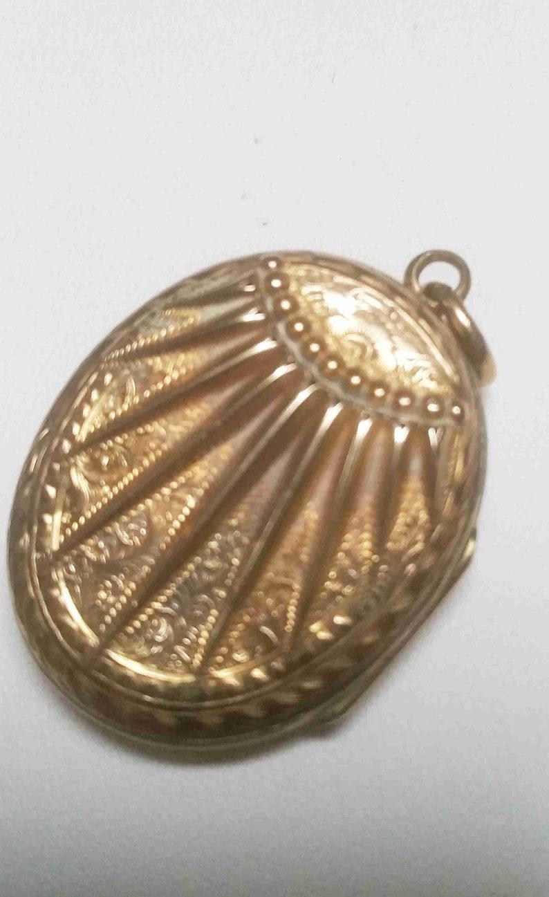 pattern on both sides Antique 9 carat gold sunburst locket