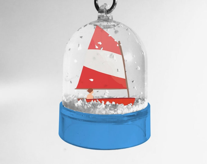 Optimistic double-sided snowball keychain from didouch