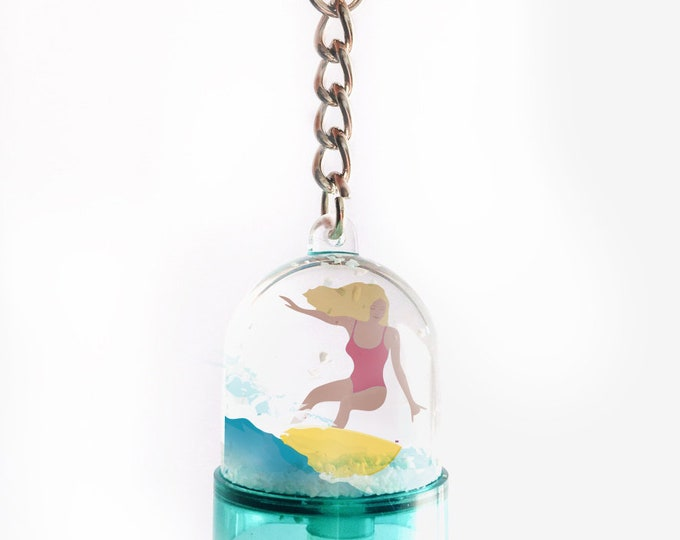 Snowball keyring two-sided from the blonde or brown didouch surfer