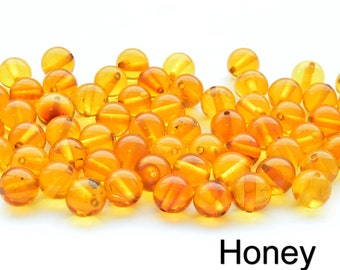 Dark Honey Bean Natural Amber Drilled BeadsCrafters 11mm-7mmApprox 60 amber beads in each 10 grams Baltic Amber Beads with holes