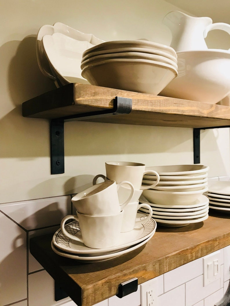 Modern farmhouse decor ideas are a hot commodity. Because let's face it, decorating a modern farmhouse {or any other house} can seem overwhelming to most of us. These shelves would look great in any room in the house!
