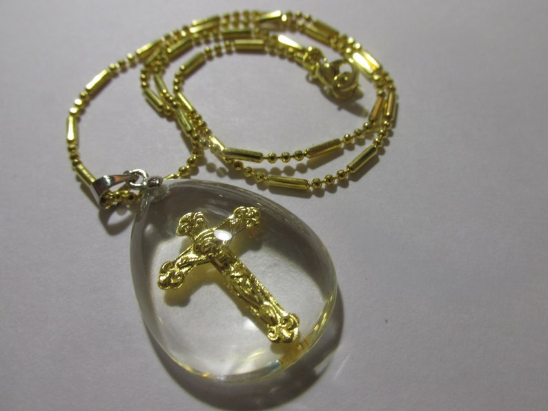 Gold Foil Cross with Jesus Charm in Acrylic Teardrop Pendant with Gold Tone Chain 16