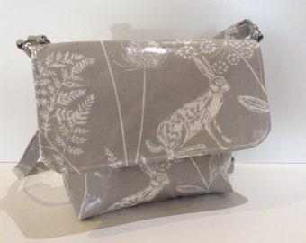 Cross body shoulder festival bag oil cloth Hares