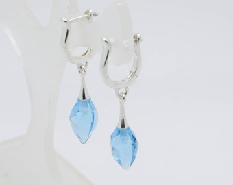 Aquamarine sterling silver earrings / March Birthday / Aquamarine coloured Swarovski twisted drop earrings