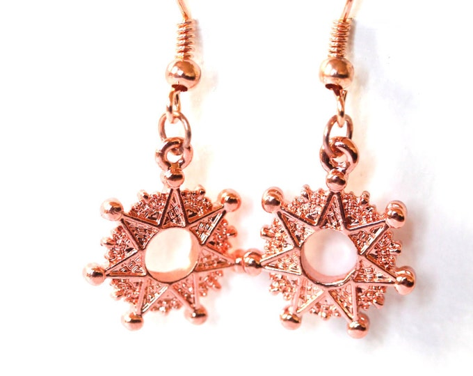 Gorgeous rosegold / bright copper earrings with a star