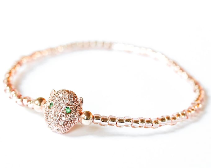 Bracelet with a rose gold panther head with zirconium, and rose gold Toho beads