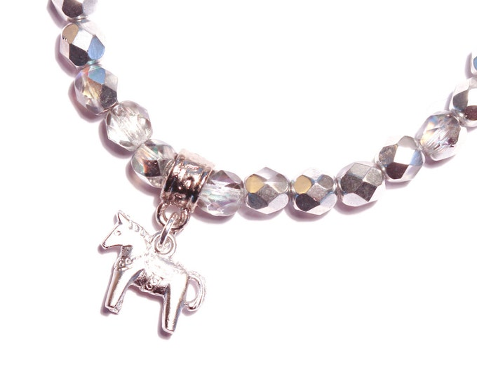 Bracelet with a silver Dala horse (Swedish horse) charm and silver faceted glass beads