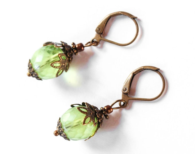 Earrings with large melon green glass beads and bronze elements