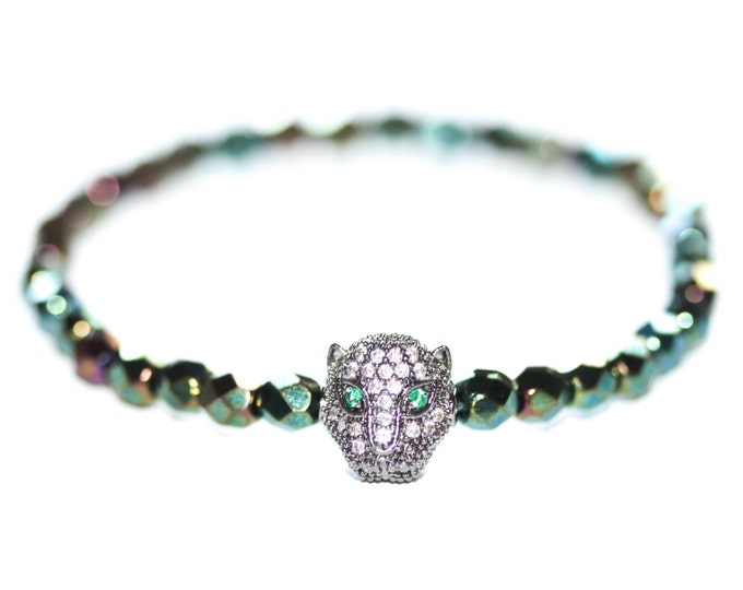 Green bracelet with Czech glass beads and a gunmetal panther head with zirconium