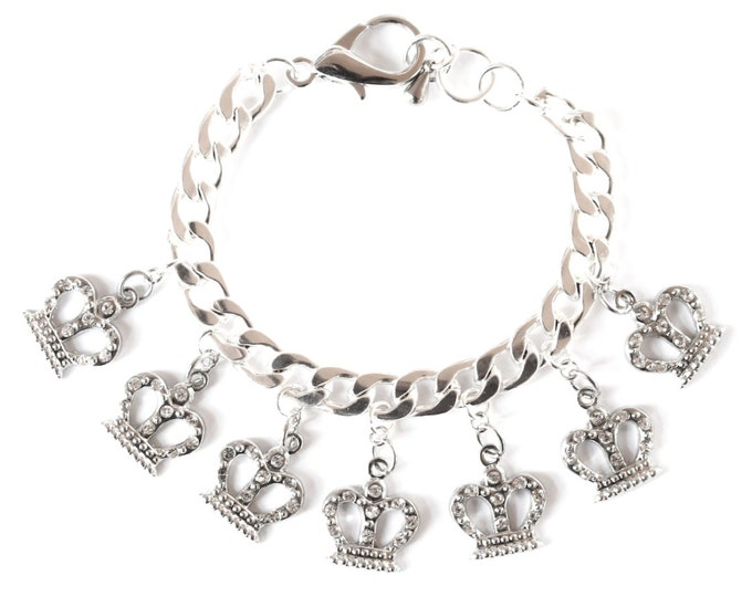 Silver bracelet with a thick chain and 7 silver rhinestone crowns charms