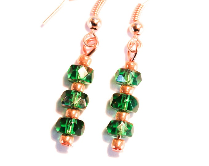 Earrings with green faceted glass beads and rose gold elements