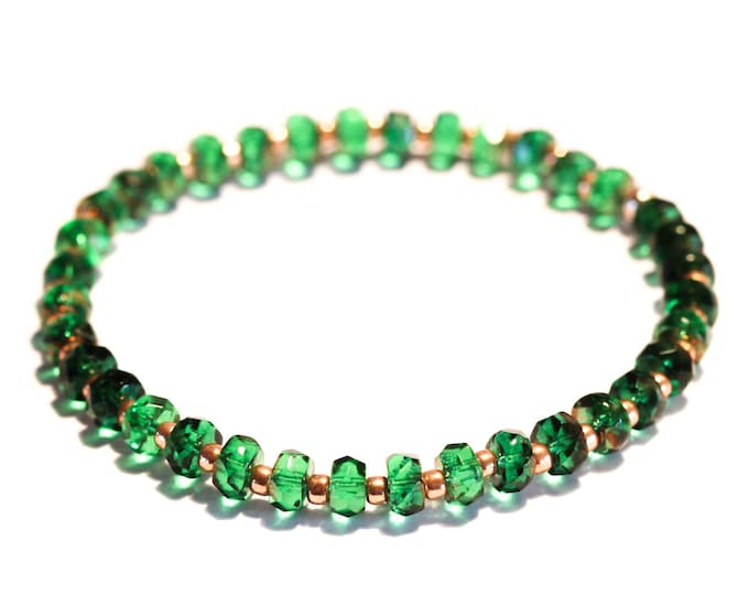 Bracelet with green faceted rondelles and rose gold Toho beads