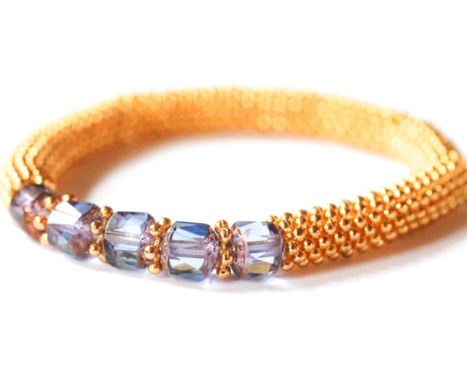 Bracelet gold daisy spacers and blue Czech glass beads