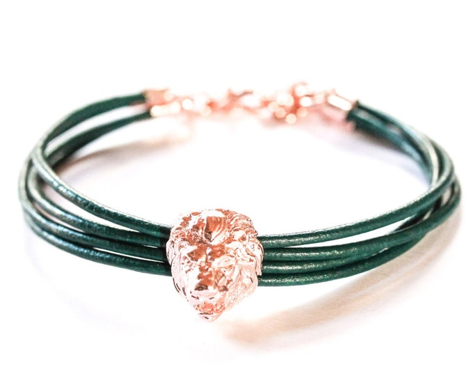 Bracelet a rose gold lion head and dark green leather cords
