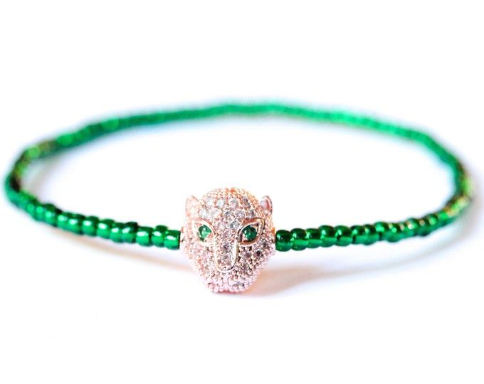 Bracelet with a rose gold panther/leopard head with zirconium and green Toho beads