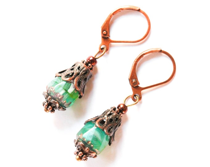 Antique style earrings with green glass beads and copper elements