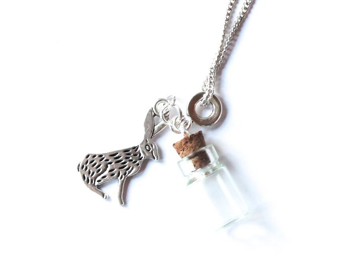 Memorial necklace with a rabbit and an empty vial