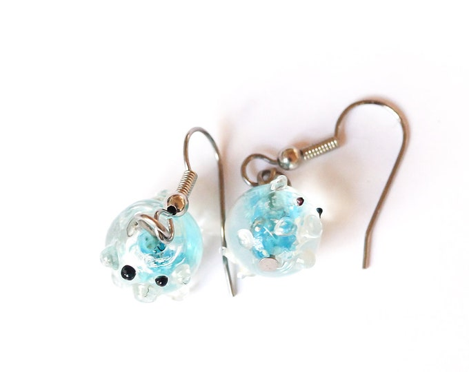 Earrings with adorable blue glass beads, with a pig shape