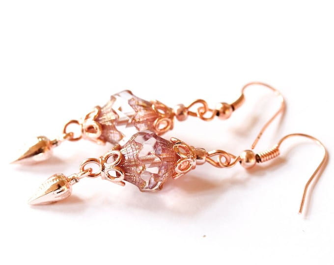Earrings with amazing clear baroque bicone beads and rose gold plated elements