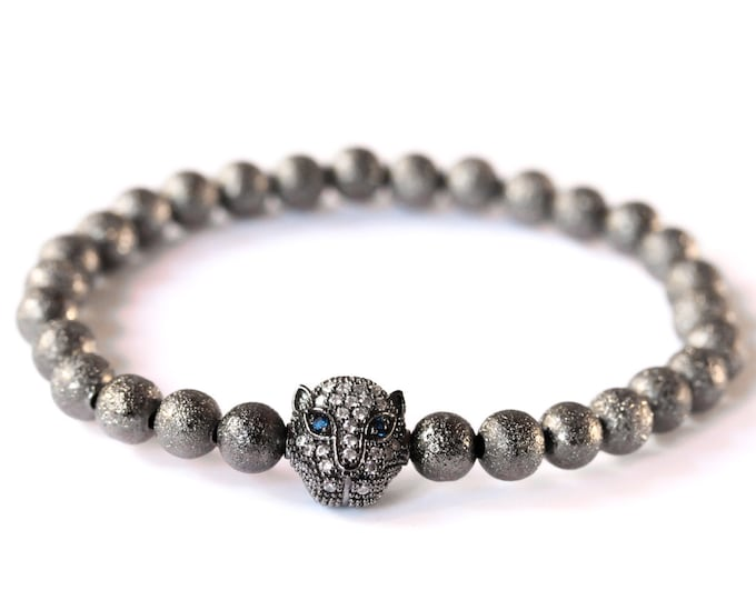 Bracelet with a gunmetal panther head with zirconium, and gunmetal stardust beads