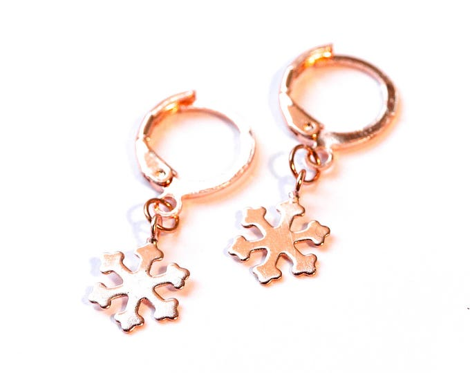 Small rose gold hoop earrings, with snowflake star charms