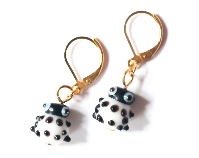 Golden leverback earrings with black and white ladybugs (handmade glass beads)