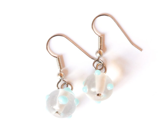 Earrings with round clear glass beads with blue dots
