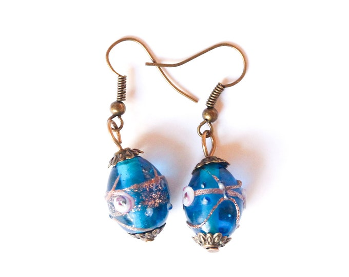 Earrings with large blue glass beads from Murano