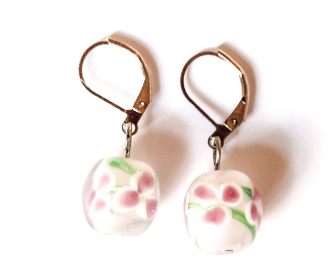 Earrings with white glass beads with pink flowers