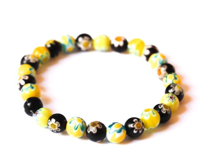 Bracelet with round millefiori beads, black and yellow