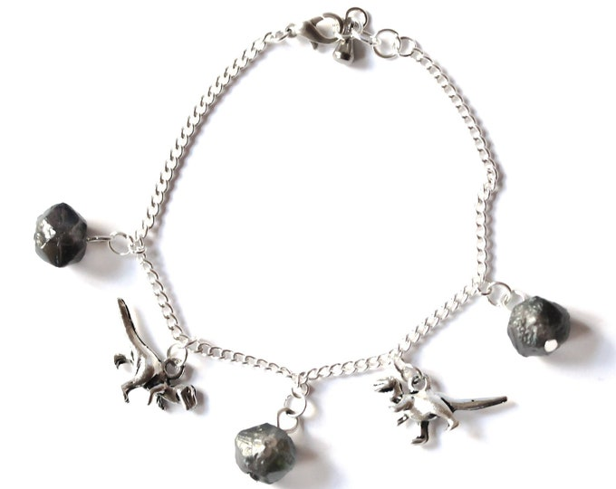 "Silver chain bracelet with dinosaurs and ""meteorites"""
