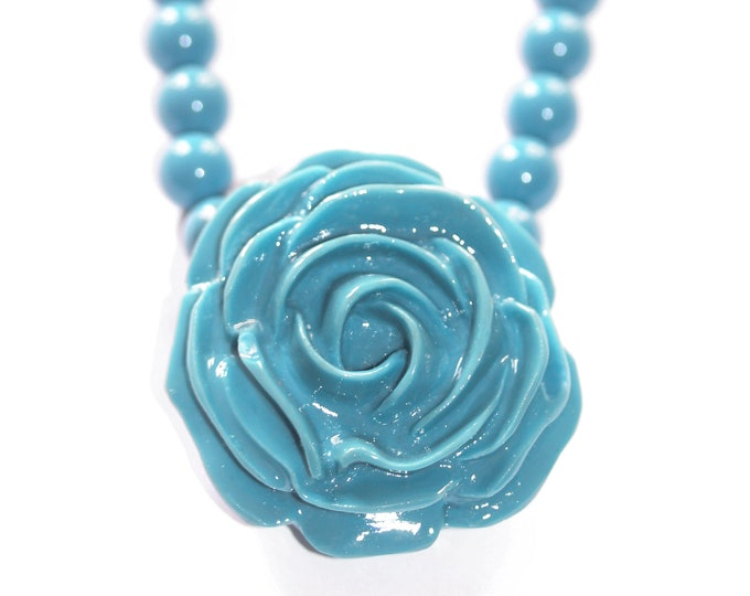 Vintage beaded necklace from the 1980s, with a blue flower