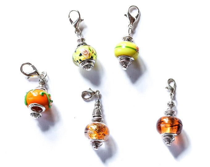 Charm / dog collar charm / pendant, with yellow/orange Murano glass charm and silver lobster clasp