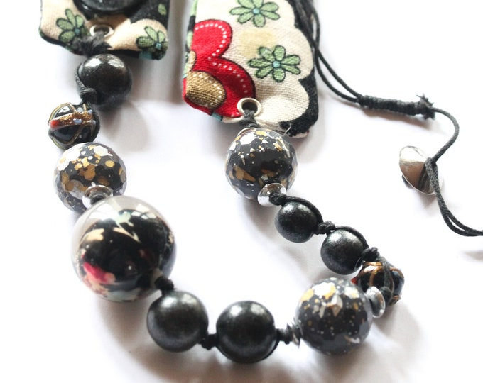 Vintage long beaded necklace, black, with beads from various material