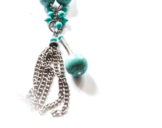 Long necklace with a long silver chain and turquoise pendants and a silver tassel