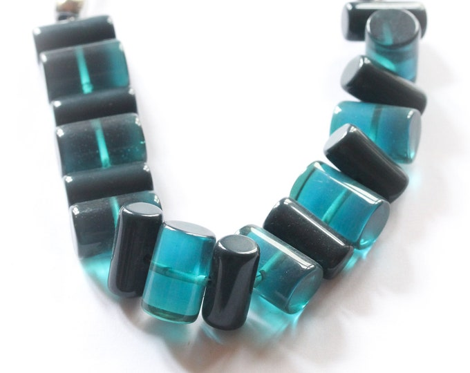 Vintage necklace from the 1980s, made with blue barrel shaped beads