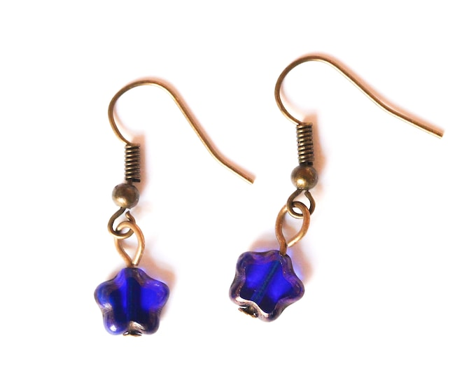 Adorable earrings with a blue Czech glass bead, star shaped