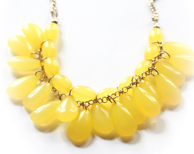 Vintage yellow necklace, with large plastic drop shaped beads
