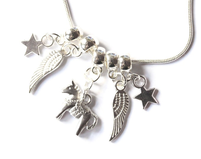 Silver plated necklace with a Dala horse, angel wings and stars