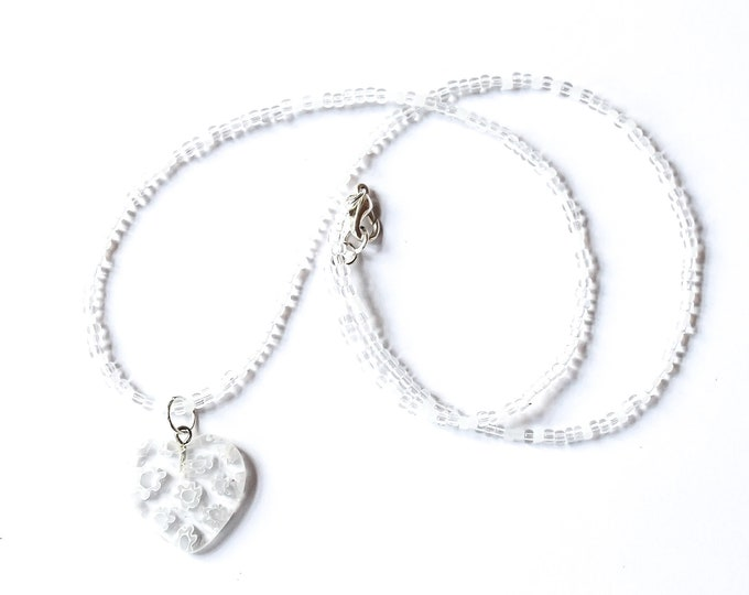 45 cm cm necklace with a large heart shaped millefiori bead, clear and white