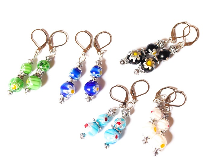 Earrings with 2 round millefiori beads (8 mm) and antique silver elements. Several colours available !