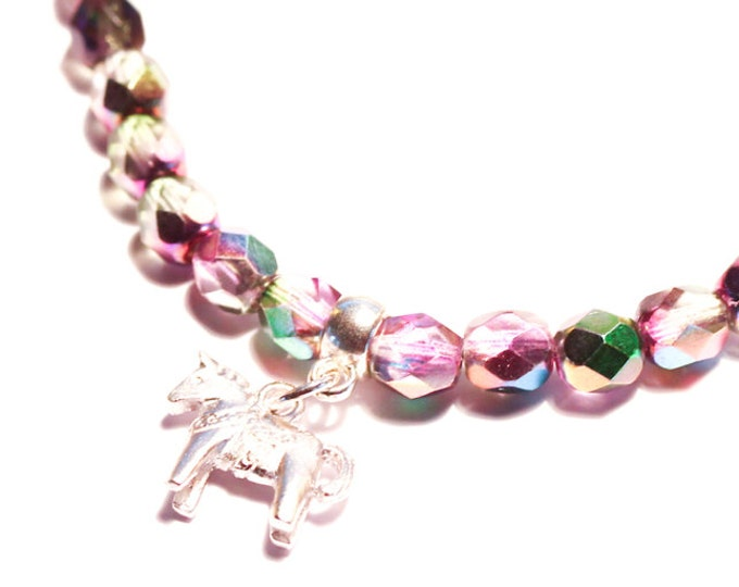 Bracelet with a silver Dala horse (Swedish horse) charm and pink rainbow glass beads