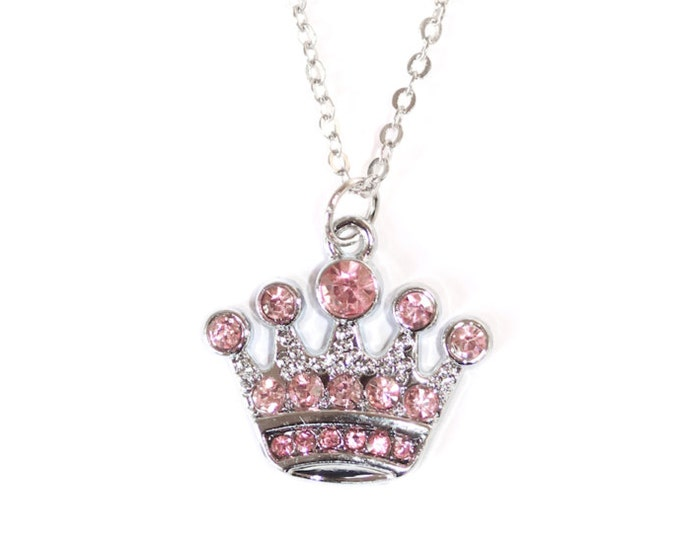 70 cm necklace/pendant with a pink rhinestones crown charm on a thin silver chain